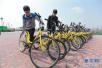 """每天30万人次骑行 青岛共享单车重回""""三国时代"""""""