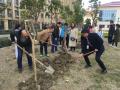 共同守护绿色!华润万家党委与师生共植树