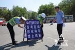 高考首日哈尔滨交通平稳有序 考场周边开启静音模式
