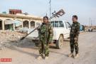 摩苏尔前线生死一刻:IS狙击手击中记者胸前相机