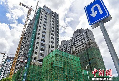 资料图:一在建楼盘 <a target='_blank' href='http://www.chinanews.com/'>中新社记者 骆云飞 摄