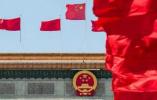 十九届中央政治局常委25日11时45分许同中外记者见面