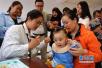 中国儿童平均身高超免票标准 专家:需要制定国标